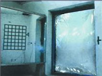 Stills from a controlled test showing the affects of a window without anti-fragmentation film